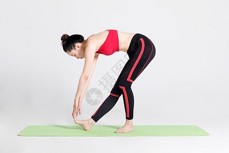 女性健身瑜伽动作棚拍图片