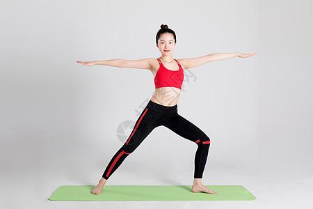 运动女性瑜伽动作棚拍图片