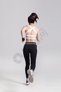 奔跑跑步的运动女性背影图片