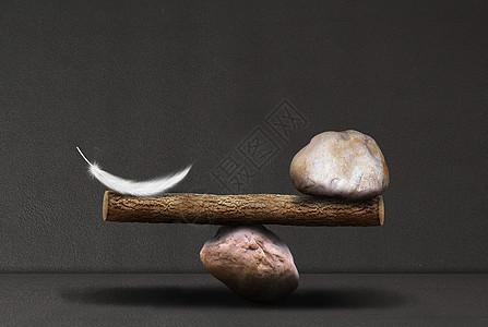 羽毛与石头的平衡图片