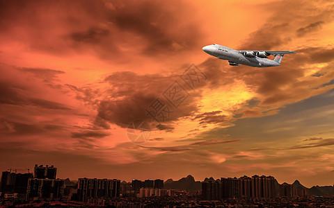 黄昏下在空中飞翔飞机图片图片