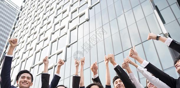 商务团队竖起大拇指图片