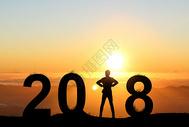 夕阳下的2018创意剪影图片
