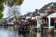 江南水乡西塘河流船只背景图片