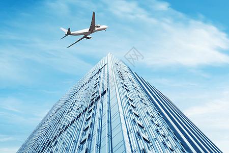 大楼上空的运输机图片