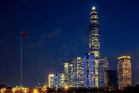 国旗与高楼大厦夜景图片