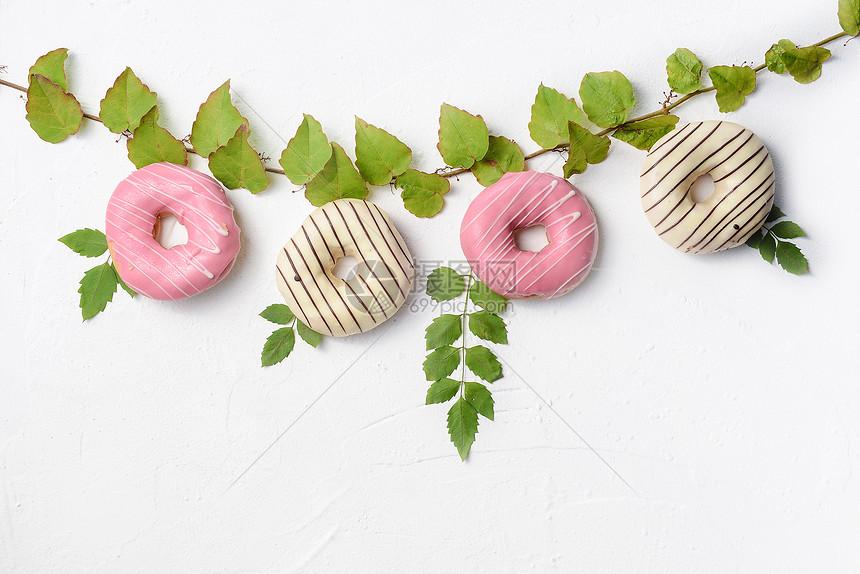 创意清新甜甜圈面包图片