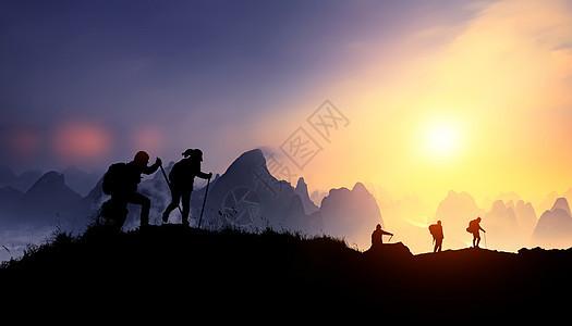 励志夕阳登山剪影图片