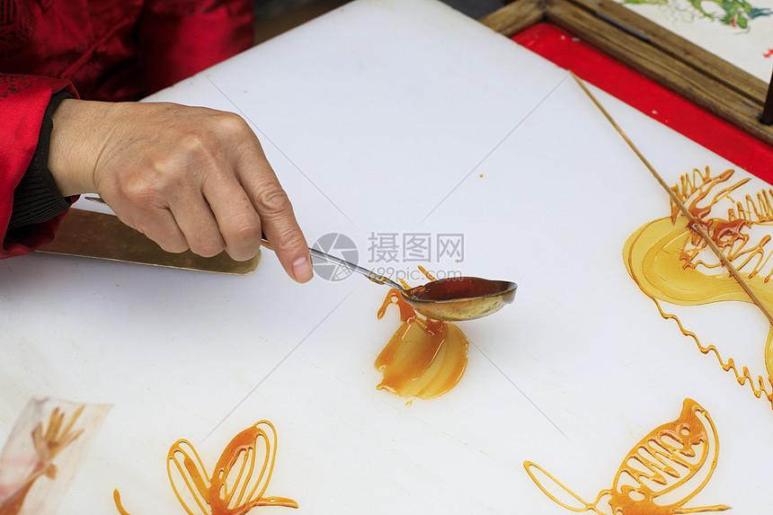 四川画糖人图片