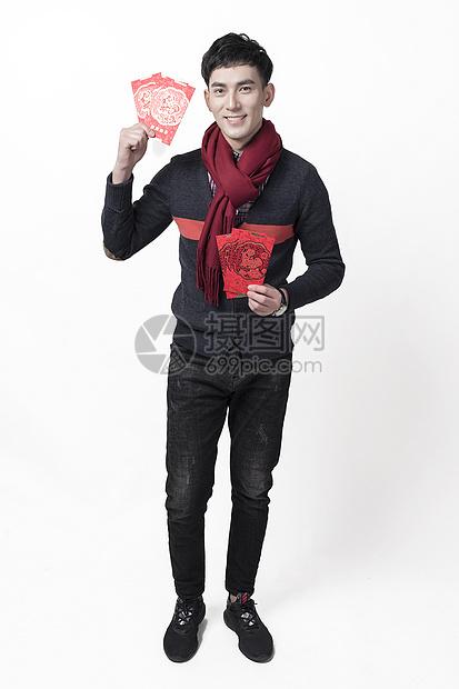 新年男士人像拿着红包图片