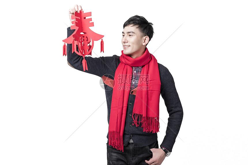 春节新年男士人像手持春字图片
