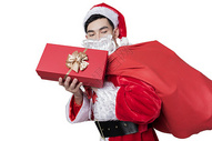 圣诞老人背礼物包裹图片
