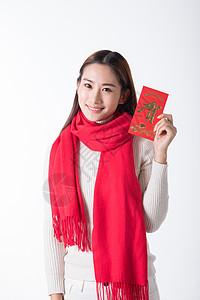 新年女性手拿红包高清图片