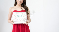 拿着新年台历年轻女性图片