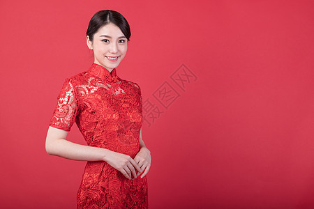 新春身穿旗袍的东方美女图片