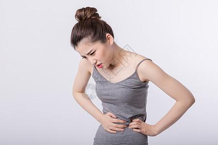 胃疼的女孩图片