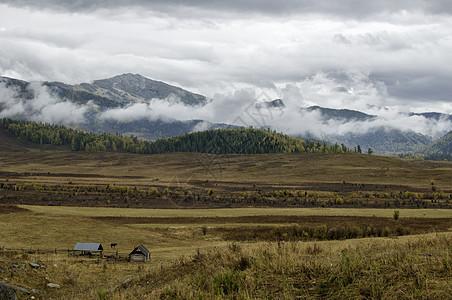 新疆禾木云海山峰村庄图片