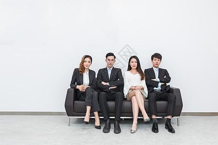 坐成一排的商务人士创意照图片