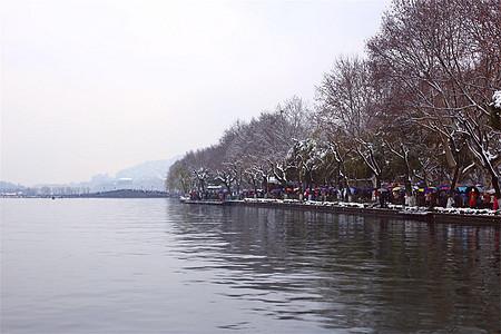 下雨下雪天的西湖图片