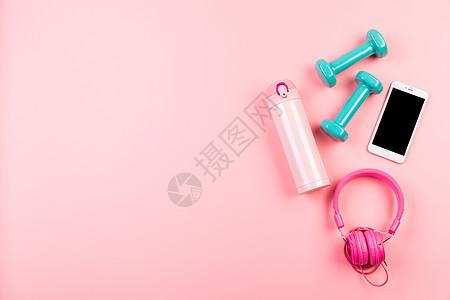 女性粉色健身静物背景图片