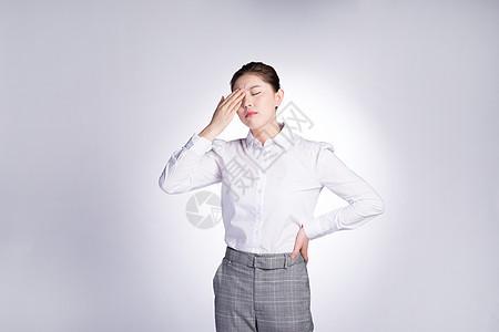 商务女性职业病头疼图片