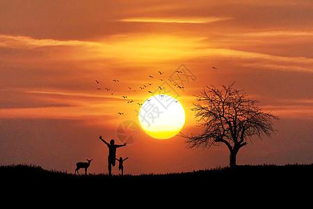 夕阳下小孩与鹿剪影图片