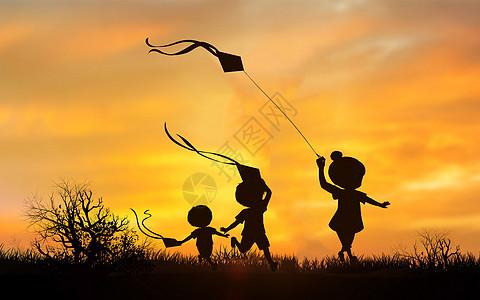 夕阳下放风筝的孩子图片