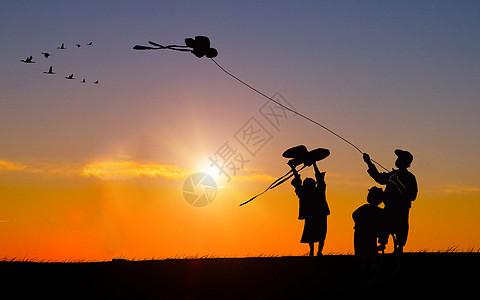 黄昏下放风筝剪影图片