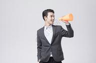 拿着喇叭的职业男性图片