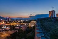 欧洲古堡与城市日落图片