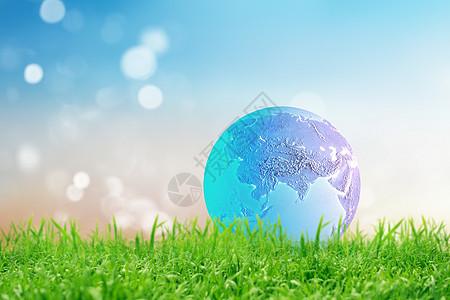 草地上的地球图片