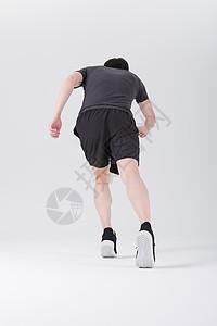 健身运动员跑步冲刺背影图片