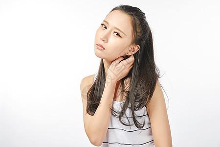 青年女性脖子疼表情图片