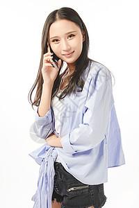 年轻女孩打手机讲电话动作图片
