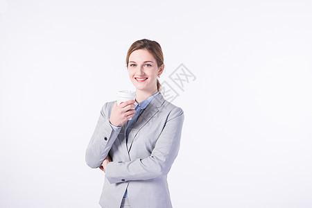 喝咖啡的外国商务女性图片
