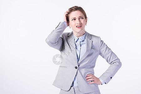 苦恼的外国商务女性图片