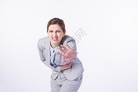 外国商务女性肚子痛图片