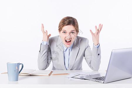 外国商务女性办公抓狂图片