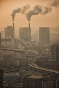 烟雾下的现代城市大连图片