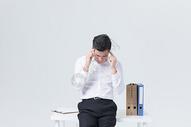 商务男性头疼状态图片