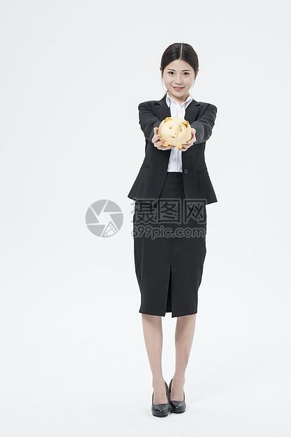 拿着金猪的职业女性图片