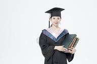 拿着书本的毕业女大学生500879803图片