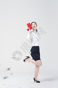 职业女性手拿喷钱枪图片