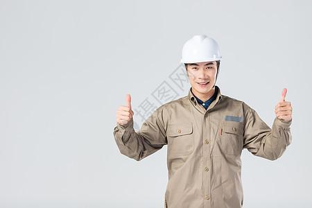 举大拇指的工人图片