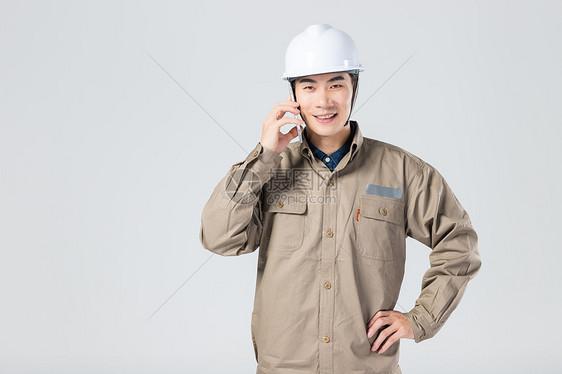 工人用手机打电话图片