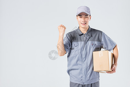 拿着快递箱的快递员握拳图片