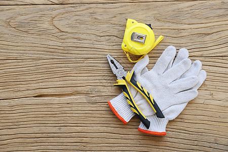 劳动节工人手套卷尺钳子图片