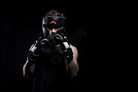 戴着拳击手套和护具的运动男性图片
