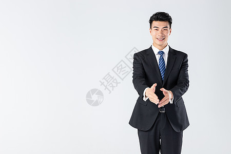 商务男士握手欢迎图片