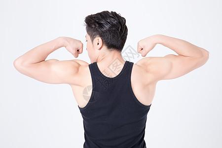 运动健身男性人像肌肉展示背影图片